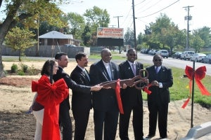 A ribbon cutting at the completion ceremony.  Photo credit: Interfaith Partners of the Chesapeake.