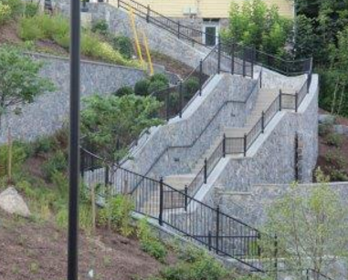 A stormwater flume connects flow from Main Street to a series of BMPs in the staircase. Photo credit: BUBBA Awards.